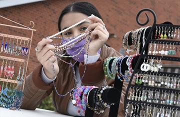 Milton Youth Action Team leader Amber Siddiqui shows some the necklaces she made for the Halton Youth Initiative's 'Crafting for a Cause' sale in support of 'Bridging the Gap', which provides shelter and support for youth.