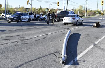 Halton police are investigating a bizarre sequence of events that caused multiple crashes and left a street light and utility box strewn across Derry Road in Milton.