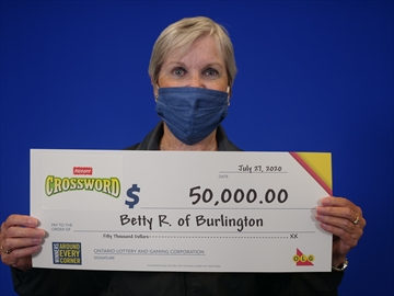 Betty Russell, 73, of Burlington is $50,000 richer after winning an Instant Crossword she bought at the Busy Bee Variety on Plains Road.