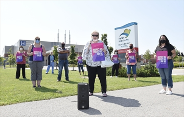 CUPE local 815 president Lorrie Kennedy speaks at a hospital workers rally out front Milton District Hospital. The hospital workers were protesting proposed wage cuts and concessions as their union continues to negotiate with the provincial government.
