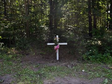 A cross marks the location where the body of a 16-year-old boy from Brampton was found in rural Milton on June 30, 2020. July 8, 2020