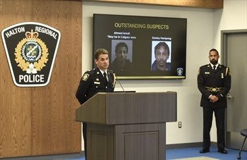 Halton Police Superintendent Kevin Maher provides an update on the Ezekiel Agyemang, 16, homicide on Sept. 17. He was joined by Peel Police Superintendent Nav Chhinzer (right). Halton police have made two arrests and have issued arrest warrants for Ahmed Ismail and Stanley Frempong.