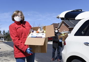 Bernadine Galway and Faizan Jamal were among the hundreds of people who responded to Milton COVID Assistance, volunteering to deliver food and other household supplies to seniors, the disabled or those with compromised immune systems.