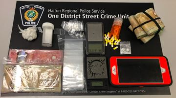 Halton Regional Police seized various items, including a quantity of drugs and cash, from residences in Milton and Mississauga. Two men from Milton and Mississauga have been arrested.