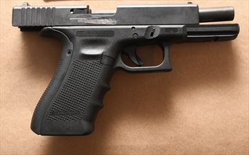 A firearm seized by Halton police after arrests were made in a series of Halton and GTA robberies.