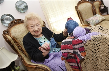 Shirley Baker, 99, is an avid knitter who — due to COVID-19 — keeps in touch with friends mainly by telephone these days.