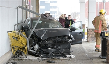 First responders assist the driver of a vehicle that crashed into the wall of a Burlington No Frills at 571 Brant St.